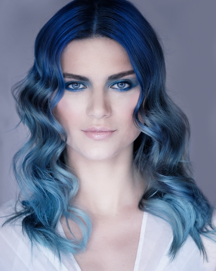 Our Nominated Finalist Image for the L'oreal Colour Trophy 2019. Hair by Oliver, creating an Ombre Mermaid inspired look. Hair blends from a rich deep blue at the root, into a lighter blue through mid lengths, then fades out to a light turquoise on the ends.