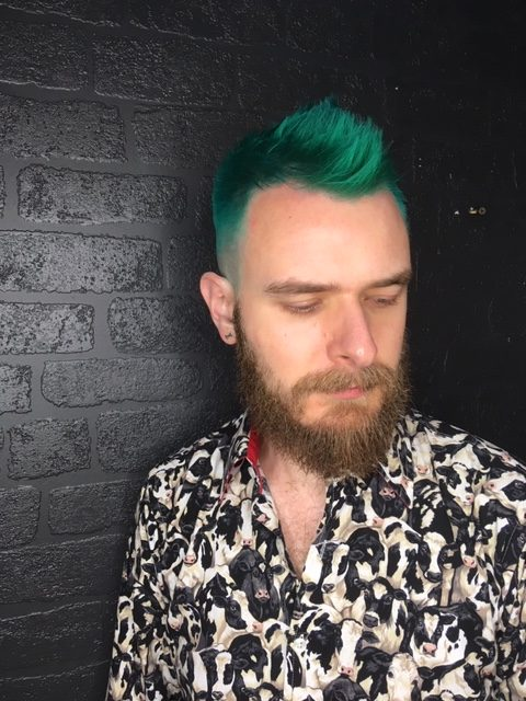 Punk Green on a male client. The men's cut is shaped to look like a modern Mohawk.